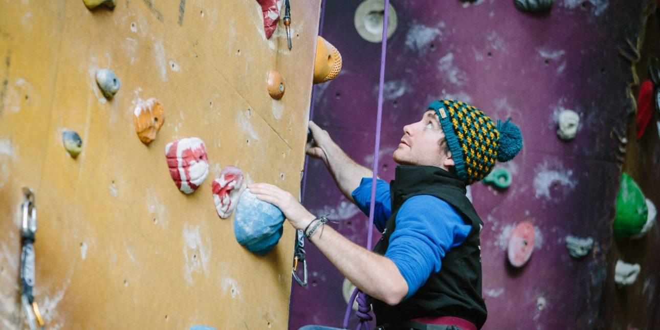 Climber on the climbing wall at Lakeland Climbing Centre