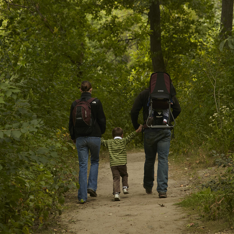 Couple hiking with child in the Twin Cities