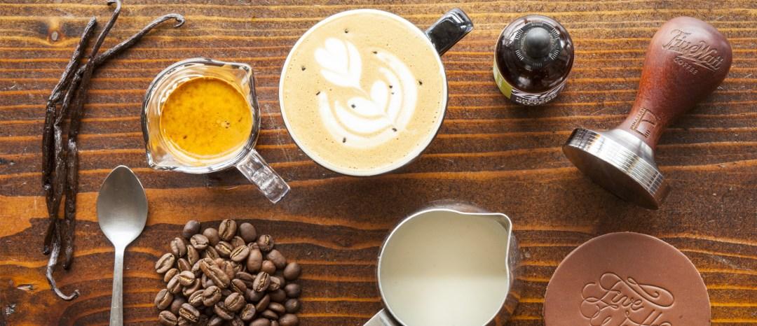 Five Watt Coffee items on wood background