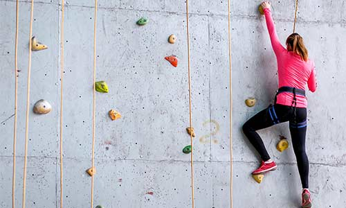 woman-indoor-rock climbing