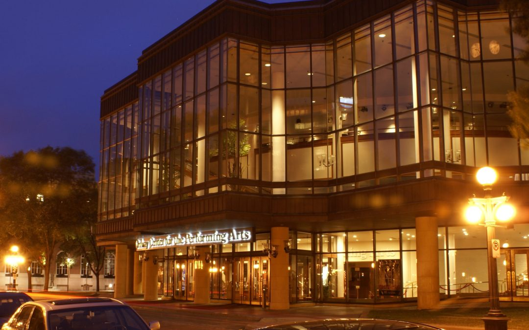 Lights shine through the Ordway Center for the Performing Arts' glass facade at night.