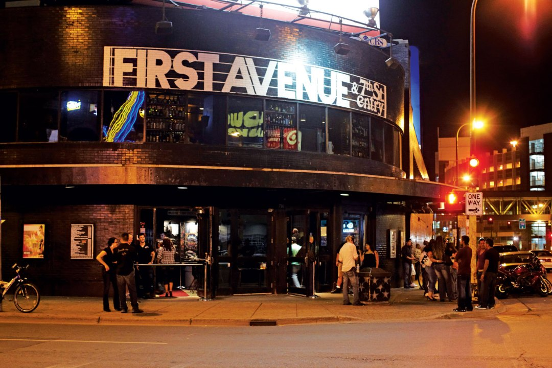 Outside the entrance to First Avenue & 7th St. Entry at night.