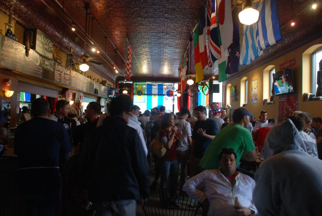 """Game Day at Nomad World Pub. Image by <a href=""""https://flic.kr/p/8afbQm"""" target=""""_blank"""">Aaron Brown/flickr</a>"""
