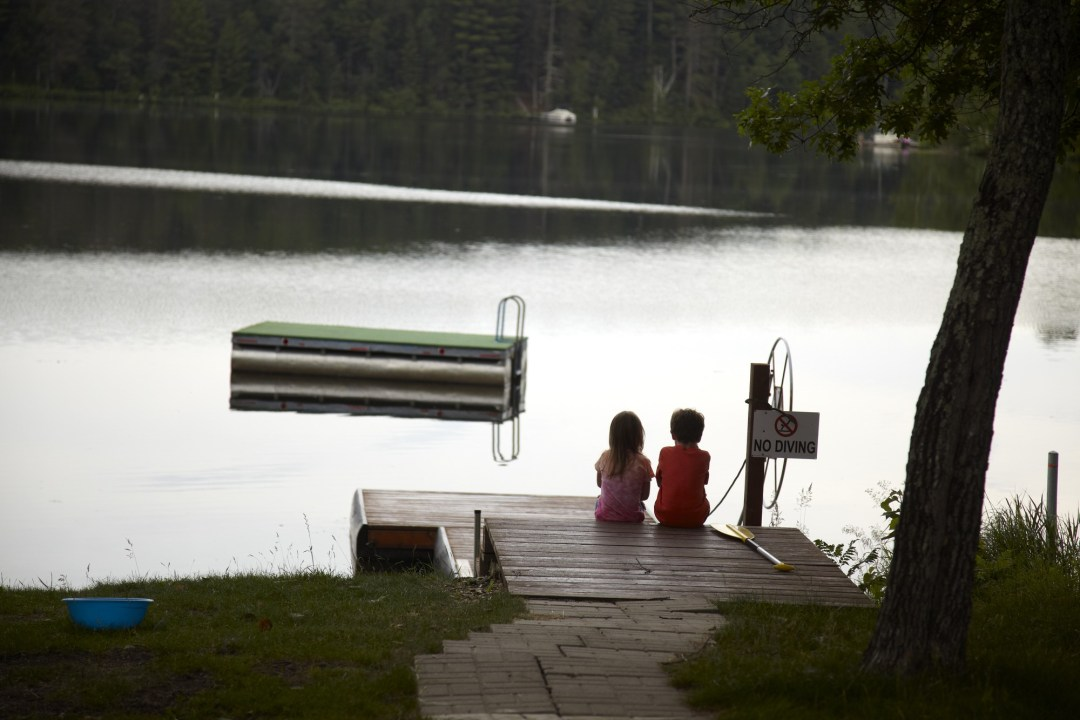 Kids fishing on dock in Hayward, WI Photo by Todd Buchanan/Greenspring Media