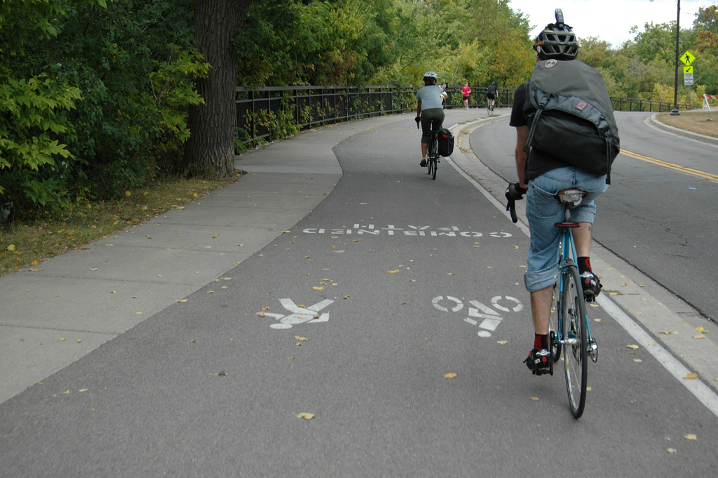"""Bikers on the Greenway. Image by <a href=""""https://flic.kr/p/assPc7"""" target=""""_blank"""">Elly Blue/flickr</a>"""