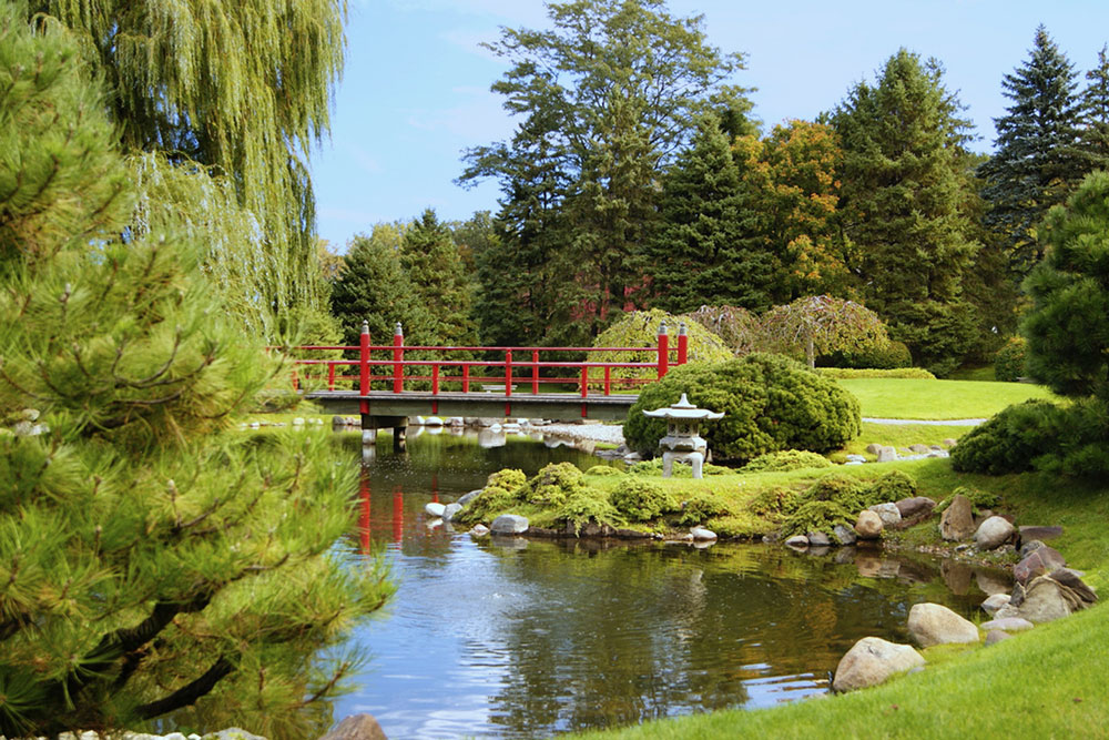 A bridge extending over a pond at the Japanese Garden at Normandale Community College.