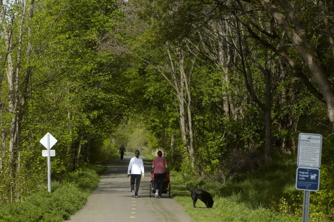 People walking down the Dakota Rail Regional Trail.