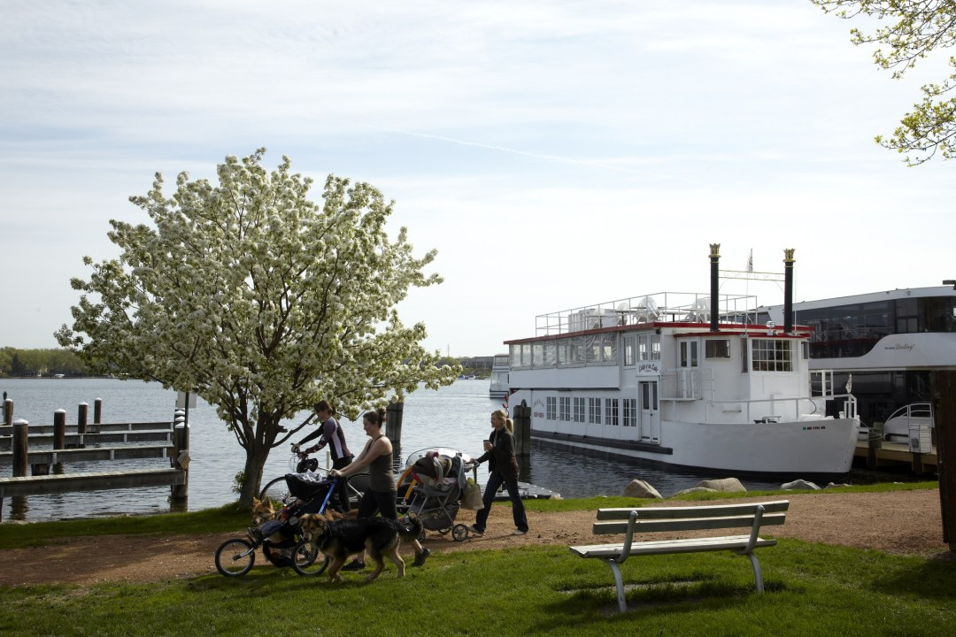 Biking and Walking Lakeside in Excelsior. Image by Todd Buchanan/Greenspring Media