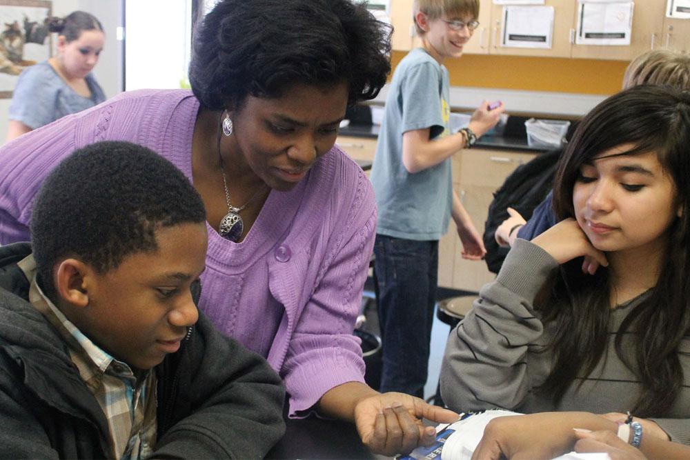A teacher instructing students at a St. Paul public school.