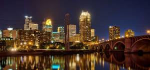 The Minneapolis skyline at night is reflecting off the Mississippi River. Seven Wonders of the Twin Cities.