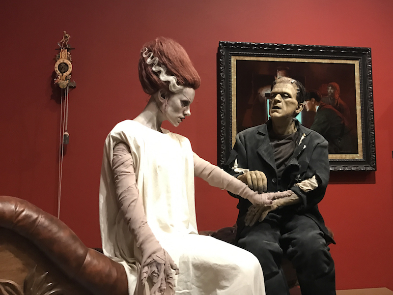 Frankenstein's monster and wife on display at an art exhibit