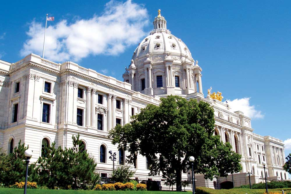 The facade of the Minnesota State Capitol on a sunny day. One of the many stops one can walk to from the Metro Transit Green Line.