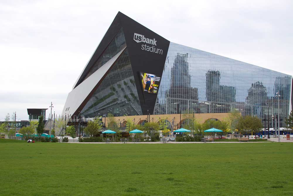 The Great Lawn at Downtown East Commons in downtown Minneapolis with U.S. Bank stadium in the background.