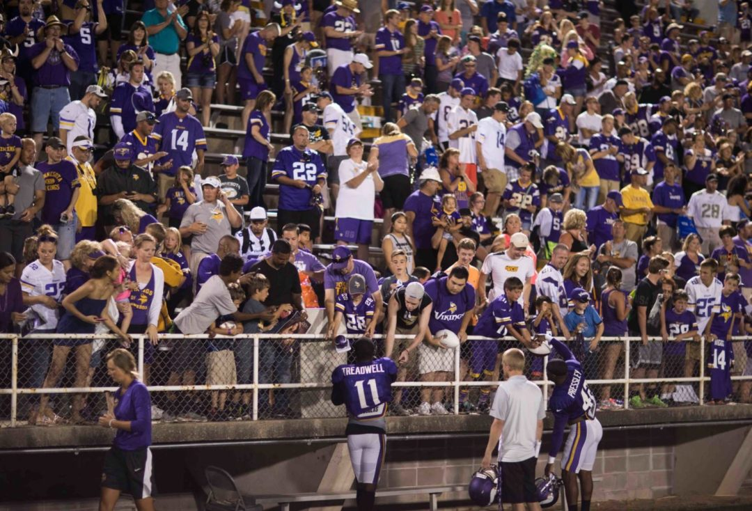 Vikings fans meet their fans during a night practice at the Vikings Summer Training Camp.