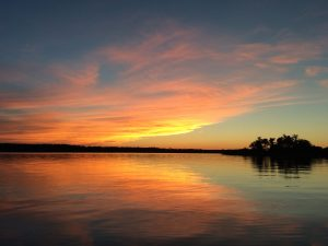 Photo of sunset on Minnesota lake.