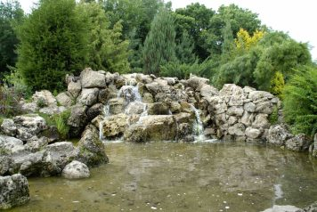 A serene rock waterfall at the Lyndale Park Peace Garden