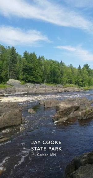 At Jay Cooke State Park, the St. Louis River flows smoothly over and around the rocks.