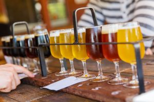 Flights of beer on a brewery table. | Breweries in the 'Burbs
