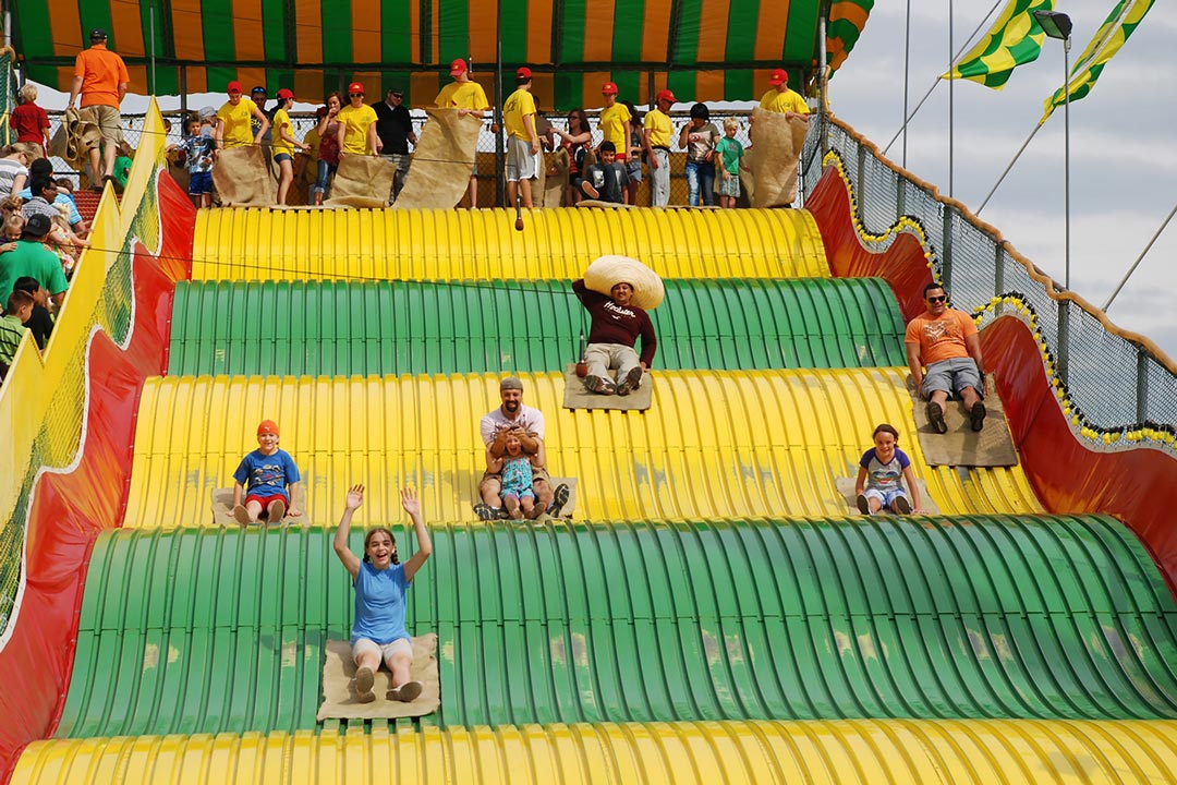 People sliding down the Giant Slide at the Minnesota State Fair.