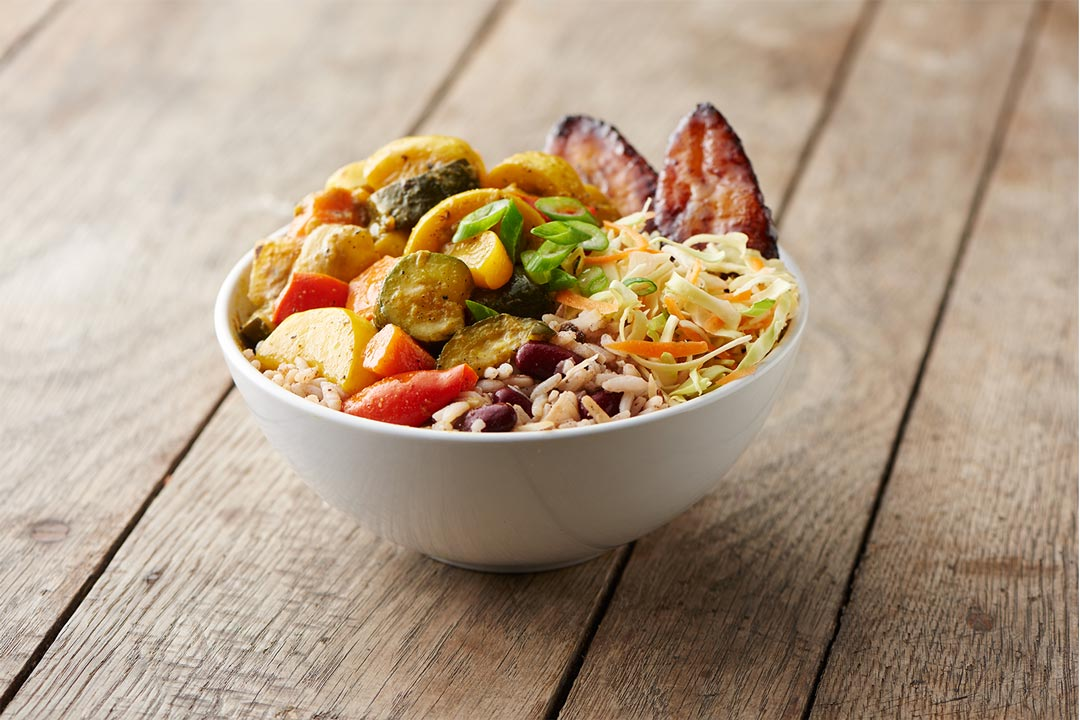 A bowl of curried vegetables at Pimento Jamaican Kitchen, one of the many Minneapolis and St. Paul restaurants.