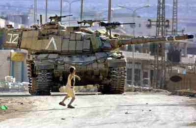 The Occupation of the American Mind still shows a boy throwing a rock at a tank.