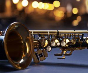 closeup of black saxophone , focus on foreground