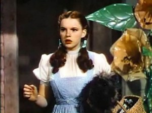Screenshot of a movie trailer with a woman dressed in a blue gingham dress