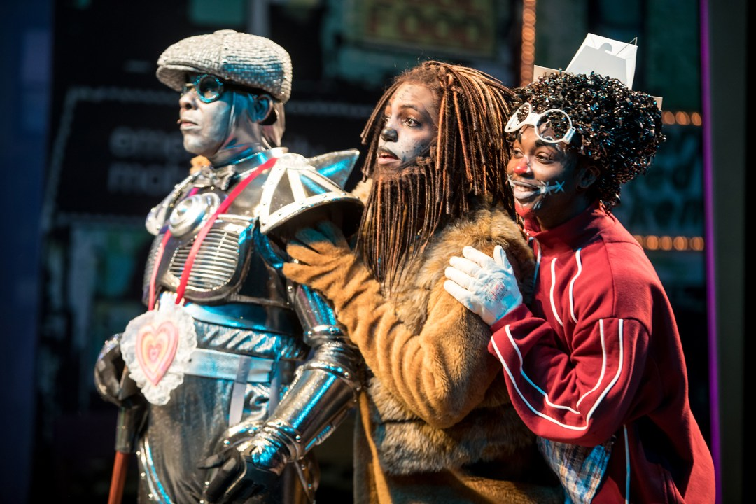 "Photo by Dan Norman. Dennis Spears (Tin Man), Rudolph Searles III (Lion) and Dwight Leslie (Scarecrow) in ""The Wiz."""