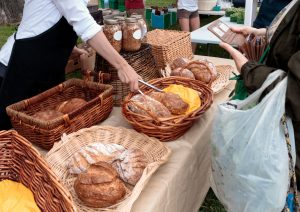 Sale of organic loaves at outdoor farmers market. Photo by alisonhancock/Fotolia.