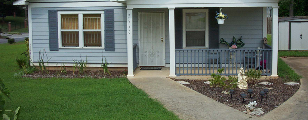 Example: A House with Zero Step Front Entrance. A concrete path leads from the driveway to the front door.