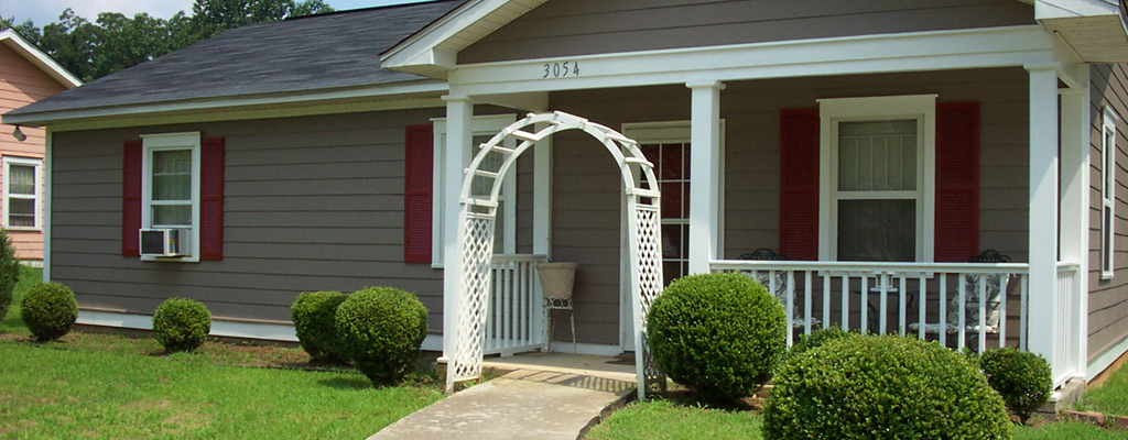 Example: Home with Zero Step Front Entrance. A concrete path leads to the front door.