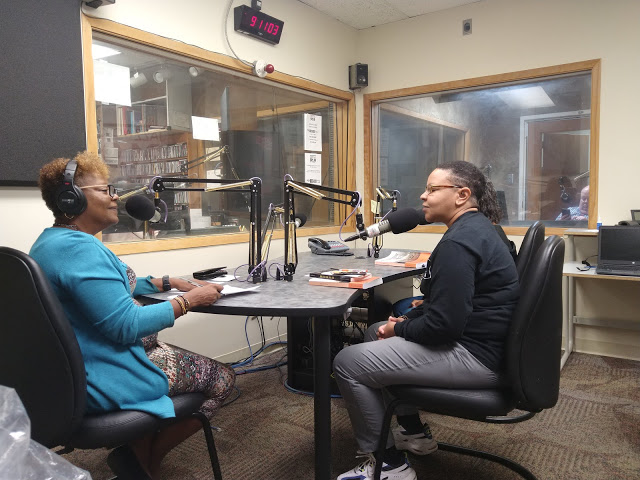 Sophia V. Nelson at WCLK studios being interviewed by Kiplyn Primus