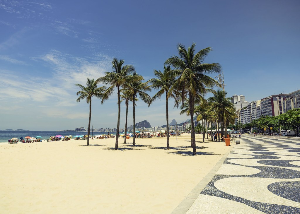 Palms on Copacabana Beach next to landmark mosaic in Rio de Janeiro, Brazil