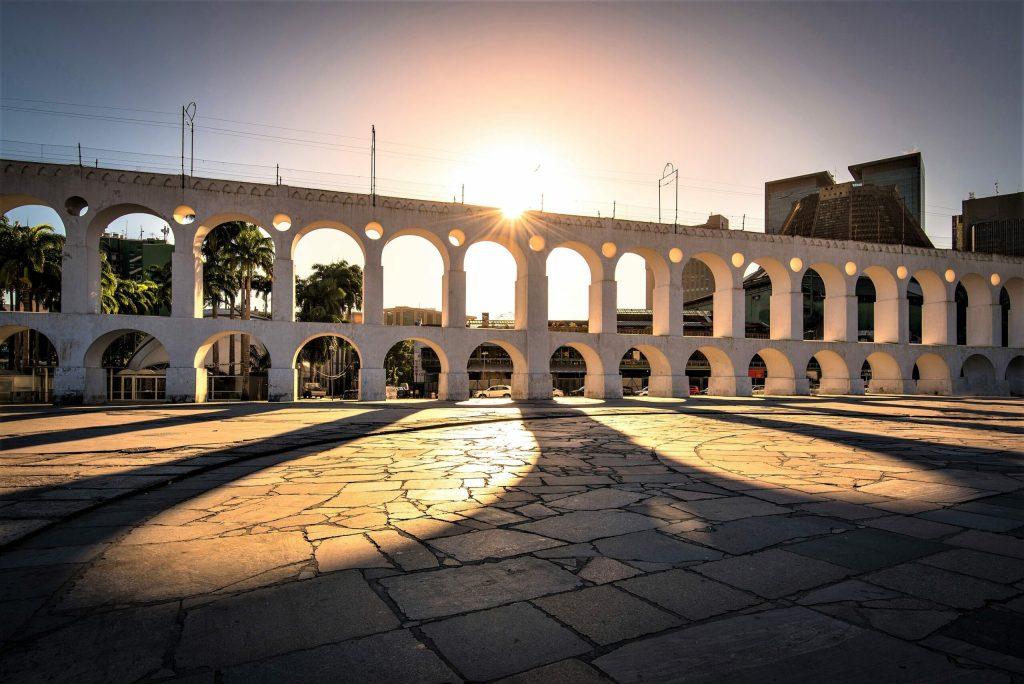 Beautiful View of Sun Shining Through Landmark Lapa Arch in Rio de Janeiro City Downtown.
