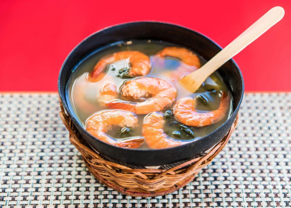 Shrimps with tucupi sauce with jambu leaves.