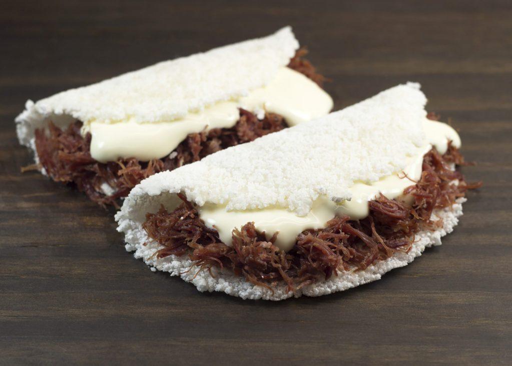 Tapioca de carne de sol com catupiry. Traditional brazilian food.
