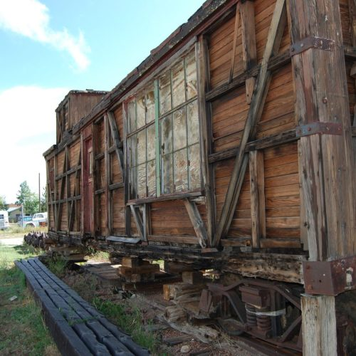 Old Rail Car sitting on wooden tracks