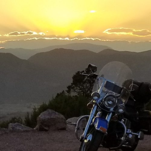 Motorcycle ride at sunset in the Wet Mountain Valley