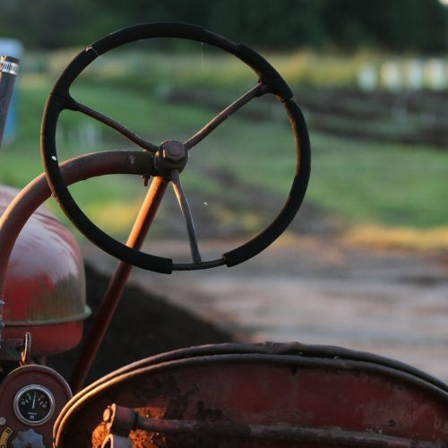 Old Tractor with farm lands in background