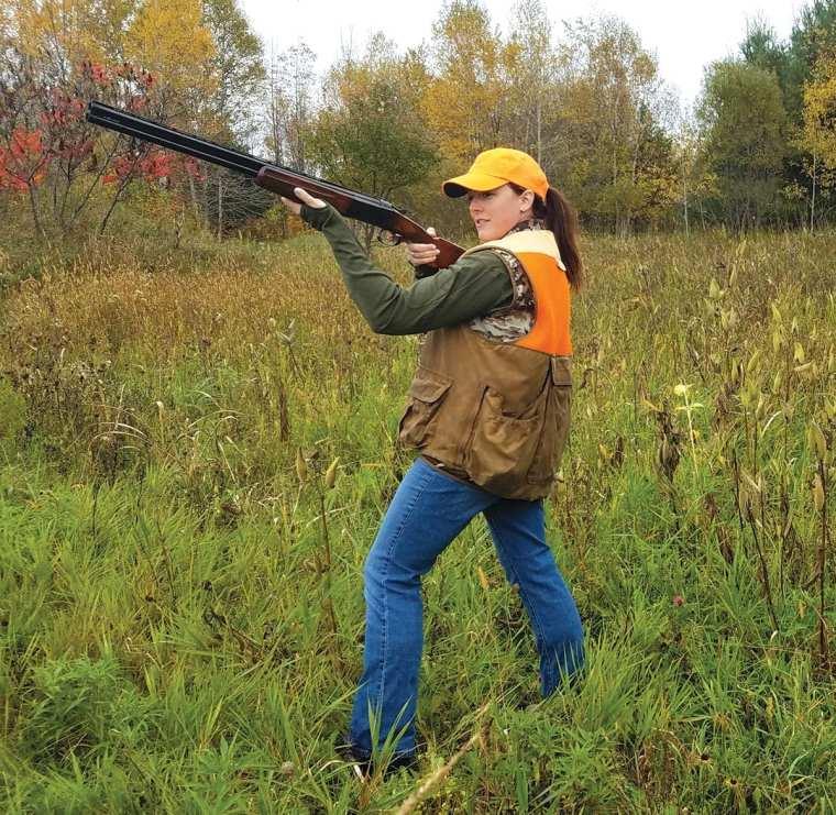 Sportswoman hunting upland birds at Silverton SportingRanch.