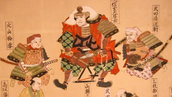 Takeda stands at the top of a painting of his descendants.