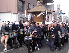 Carrying a mikoshi around the streets