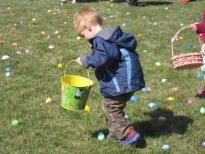 Boy collecting Easter Eggs at the Easter Egg Dash 2015