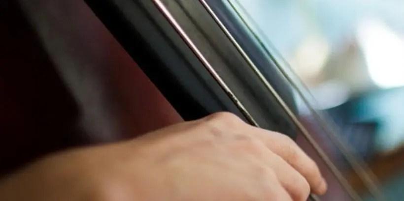 playing bass strings closeup