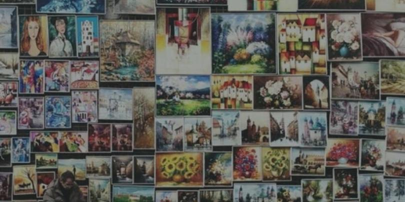 wall of colorful paintings