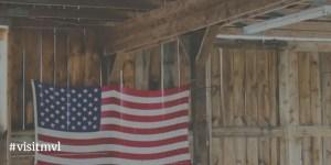 american flag hanging inside barn