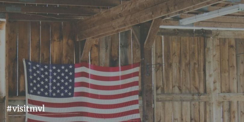 american flag hanging inside barn
