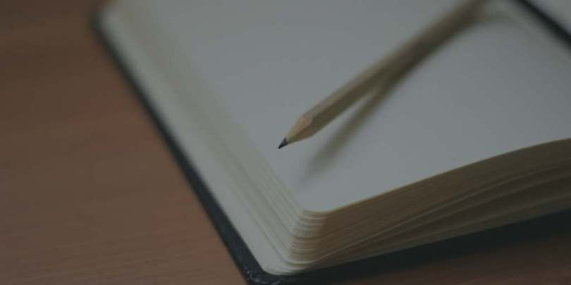 close up of a page of an open notebook with pencil