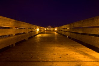 Illuminated Pier at Night
