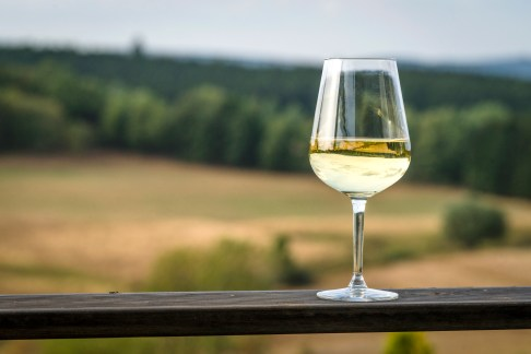 Glass of white wine on a wooden board